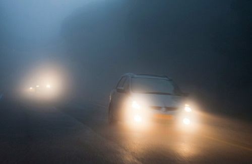 Two Cars With Fog Lights Turned On